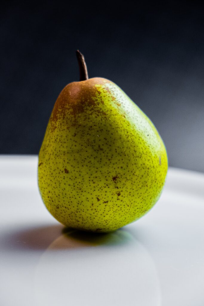 """A pear (""""ea"""" in the middle) is a fruit to eat."""